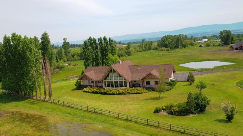 Contemporary ranch style home with Montana mountain views on 7.3 acres